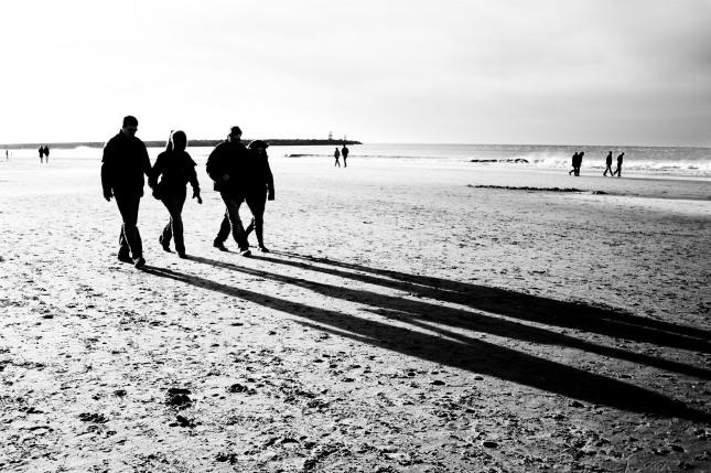 stockvault-people-walking-on-the-beach132394